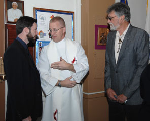 NPS Chaplain confers with Hughes' son and grandson